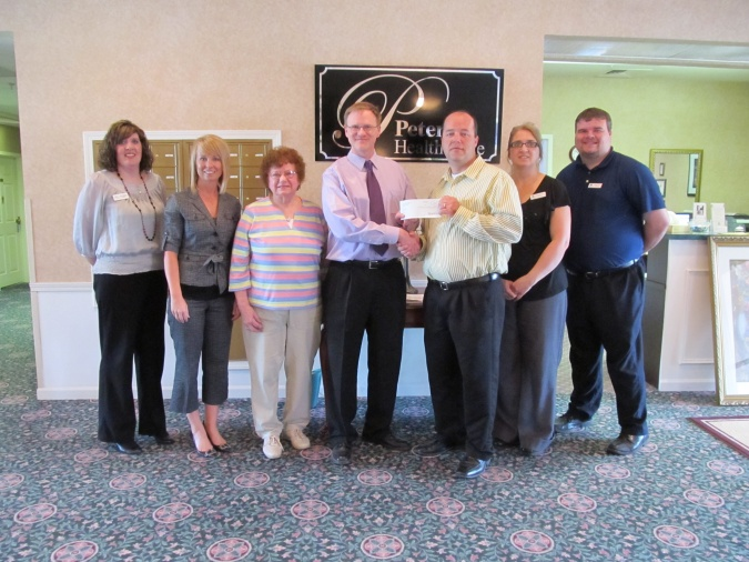Kewanee EDC Accepts Donation from Petersen Health Care
